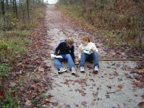 Grade school students on the trail examining animal tracks