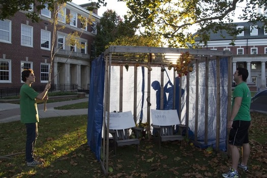 Hillel students preparing the Sukkah