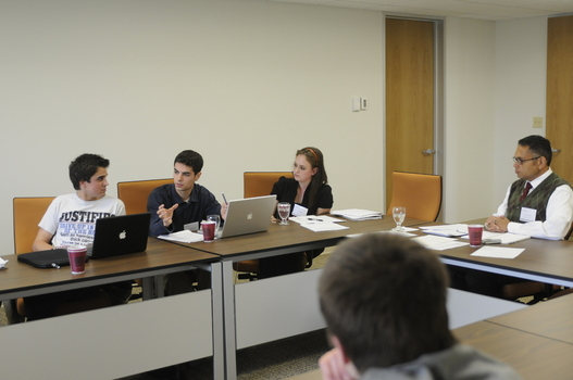 Andrew Forcehimes (Pepperdine University, left), Andrew Maddocks '11 (center) and Nicki Hewell '11 (right) debating during a workshop