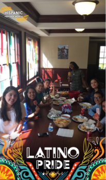 Students smiling while eating a meal