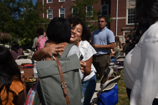 Students hugging on East College Lawn