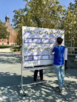 Creating posters in celebration of the 150th anniversary of women being admitted to DePauw