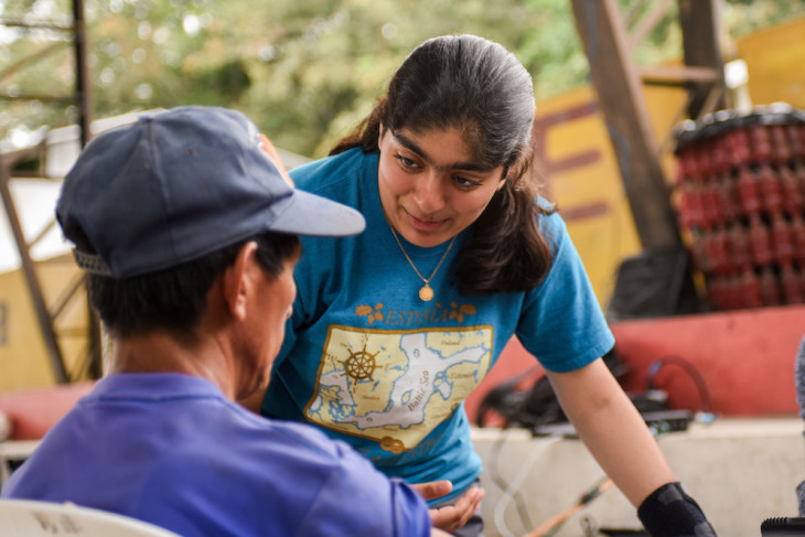 A student meets with a community member during the 2019-2020 Timmy Global Health trip.