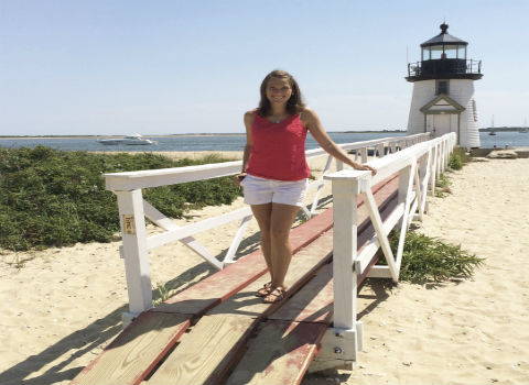 Tina Irvine '09 in front of lighthouse