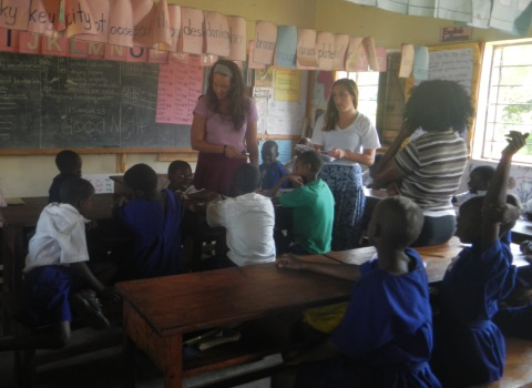Students working at a local school in Uganda