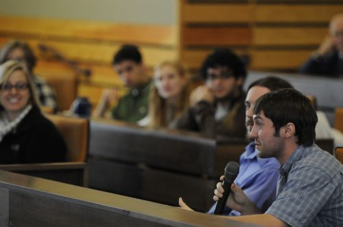 Student asking a question in an ethics session