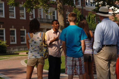 Student answering questions during guided campus tour