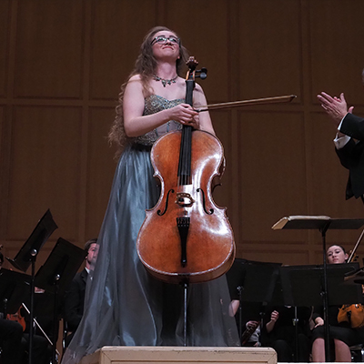 Student playing the cello in an annual concerto competition