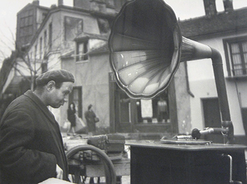 Doisneau photograph of many looking at gramophone