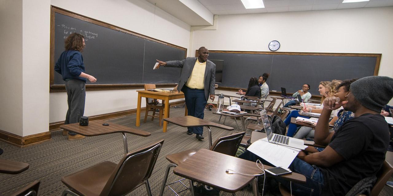Prof. Emmitt Riley teaches a class in Asbury Hall.