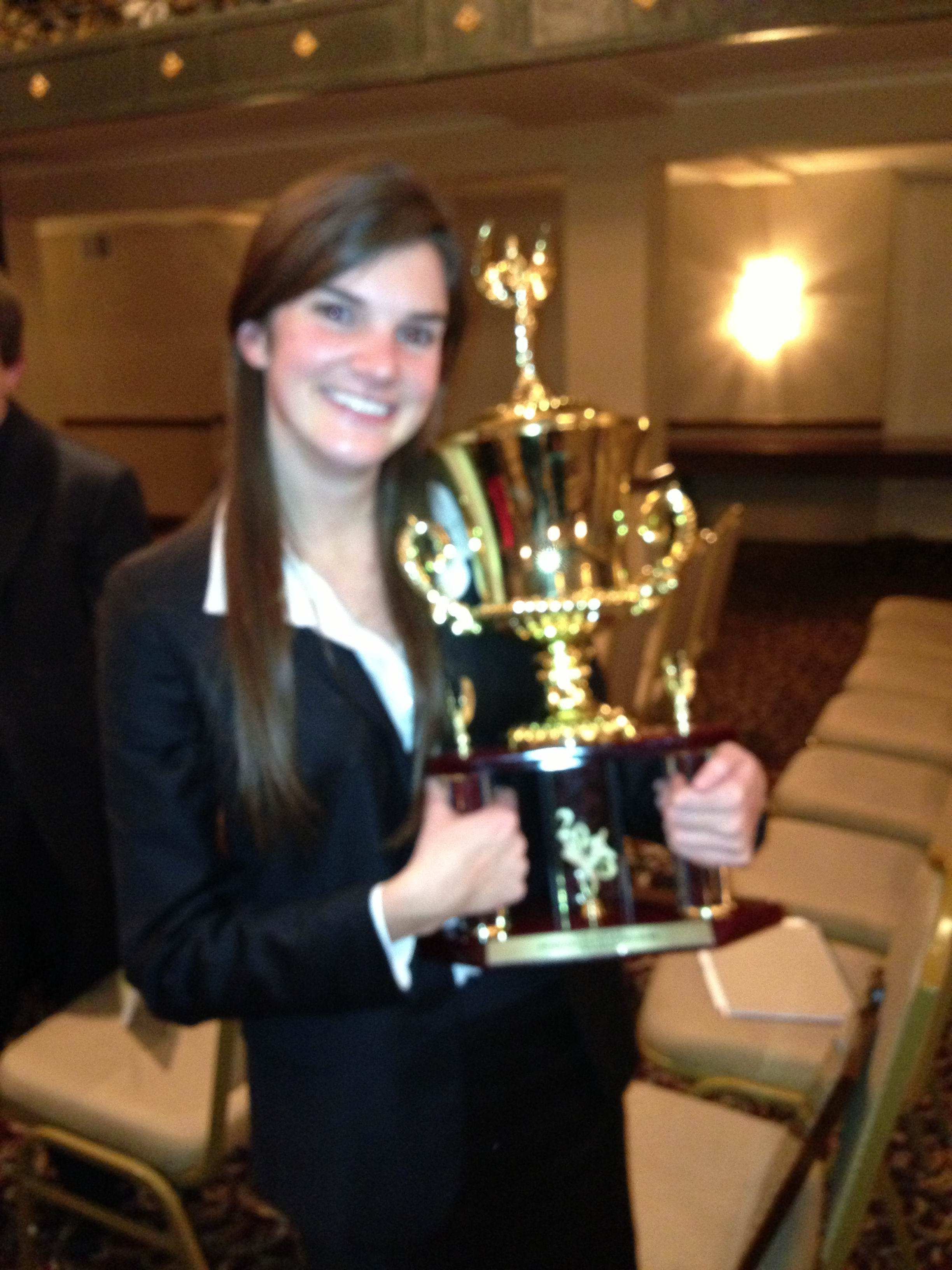 Sara Scully with the Ethics Bowl trophy