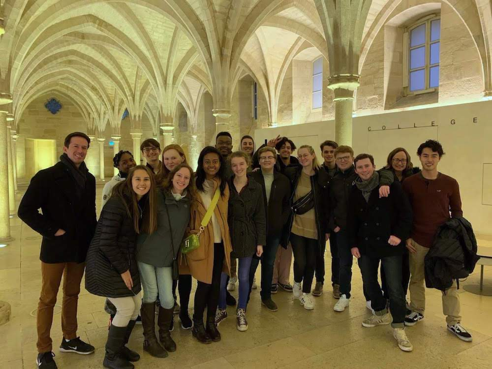 Students and faculty members take a group photo during a cultural visit in Paris.