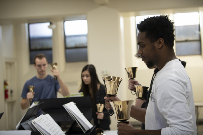Students studying for their English handbell concert
