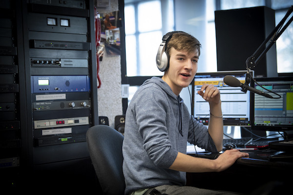 Student in the WGRE radio booth