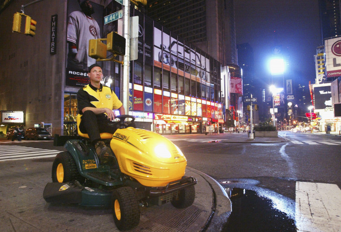 Brad Hauter on a lawnmower in Times Square