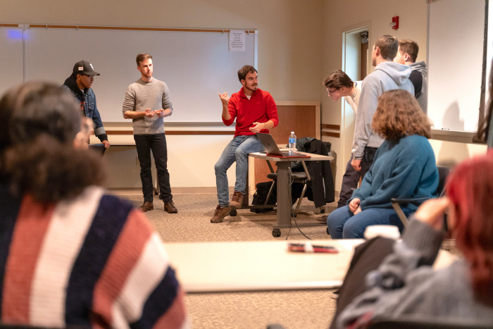 Alex Thompson '12 breaks down a scene with students.