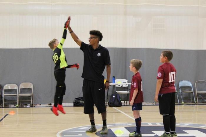 Adrian Ables teaches soccer