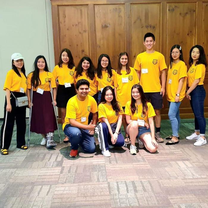 Picture of 12 19-20 International Ambassadors wearing yellow shirts