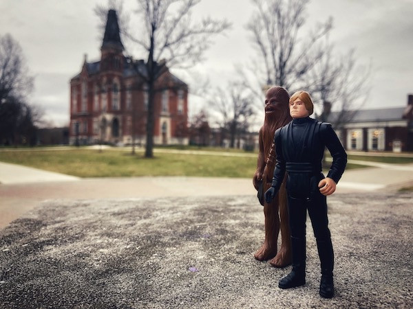 Luke Skywarlker and Chewbacca action figures with East College background