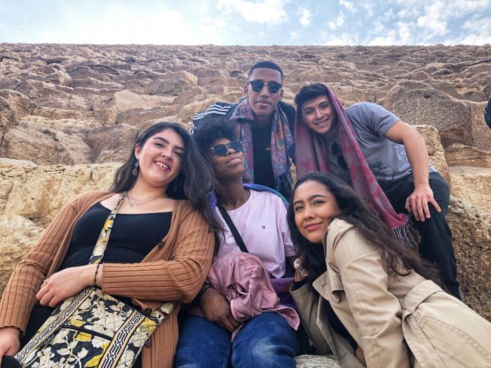 Students pose at the base of the Great Pyramid of Giza