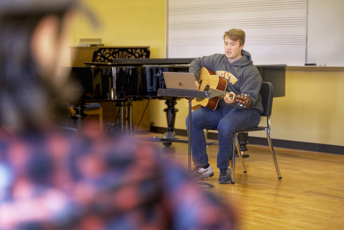 Abel Bates '22 workshops his song in class.