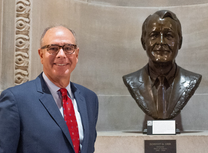 John Hammond with a bust of late Gov. Robert D. Orr