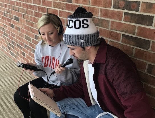 Students recording a podcast