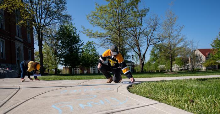Chalking seniors' names on campus