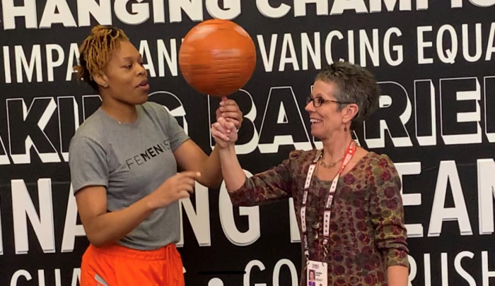 Dianna Minnick Boyce learns to spin a basketball