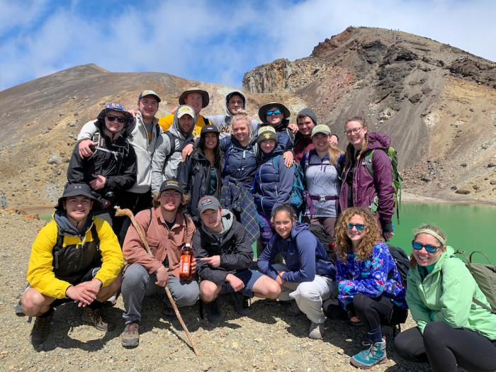Students gather for a group photo at the Tongariro Crossing in New Zealand