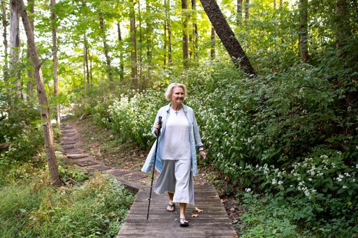 Sue Anne Starnes Gilroy walks through the woods