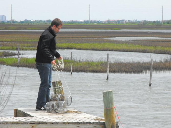Elias Oziolor conducting research near water