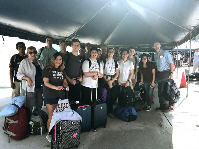 Students at the airport in El Savador