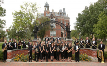 DePauw Music students gathered under the arch in front of East College