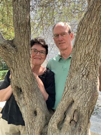 Stan and Bobbie Hendricks Bahler behind a tree