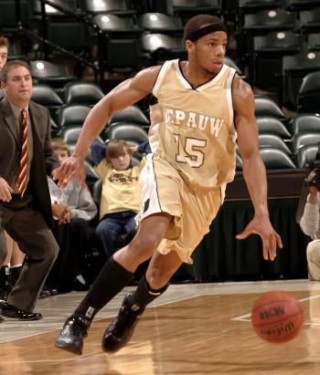 Austin Brown dribbling during a basketball game