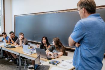 First-year students listen in Erik Wielenberg class about evil