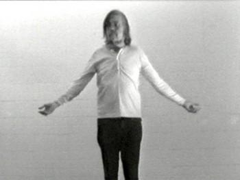 Still from I am making art by John Baldessari, b&w, mono, 1971
