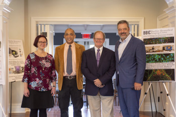 Biology professors and principal investigators of the Buehler Biomedical Imaging Center Melissa Petreaca and Pascal Lafontant with Buehler Family Foundation President A.C. Buehler '78 and Dr. Mark McCoy