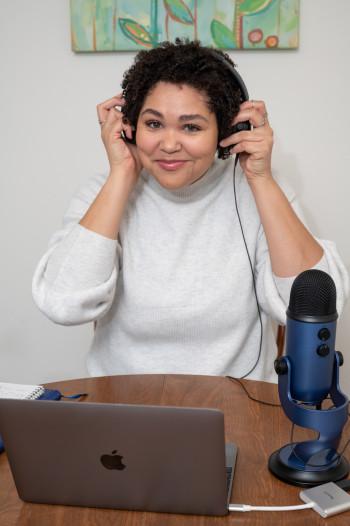 Lauren Clark adjusts headphones