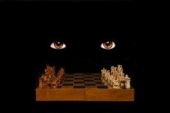 brown eyes in darkness over a chess board