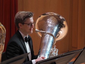 Student playing a tuba during a recital