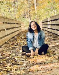 Hira sitting on the bridge at the DePauw Nature Park