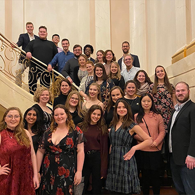 Winter Term ensemble tour members gathered along a spiral stairway