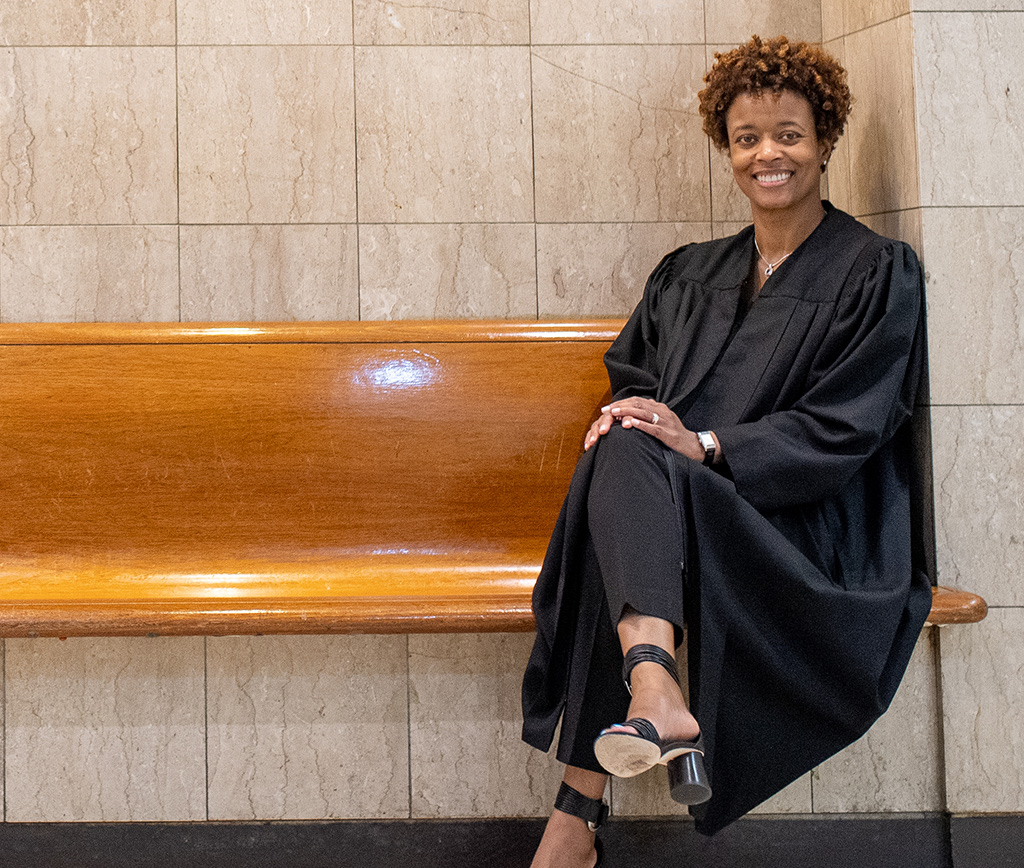Judge Shartrese Flowers seated on a wooden bench
