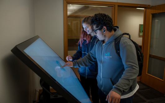 Students exploring touchscreen technology at the Tenzer Center