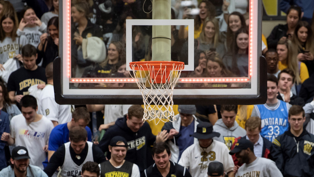 Basketball net with crowd in the back