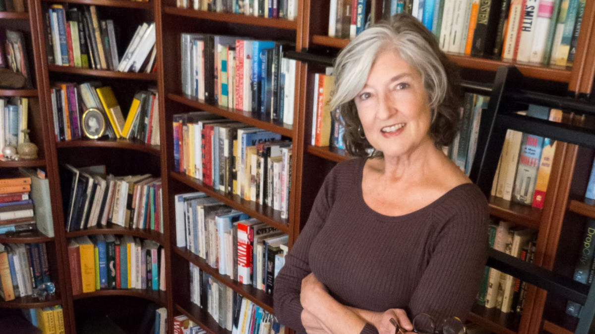 Author Barbara Kingsolver in front of bookshelves