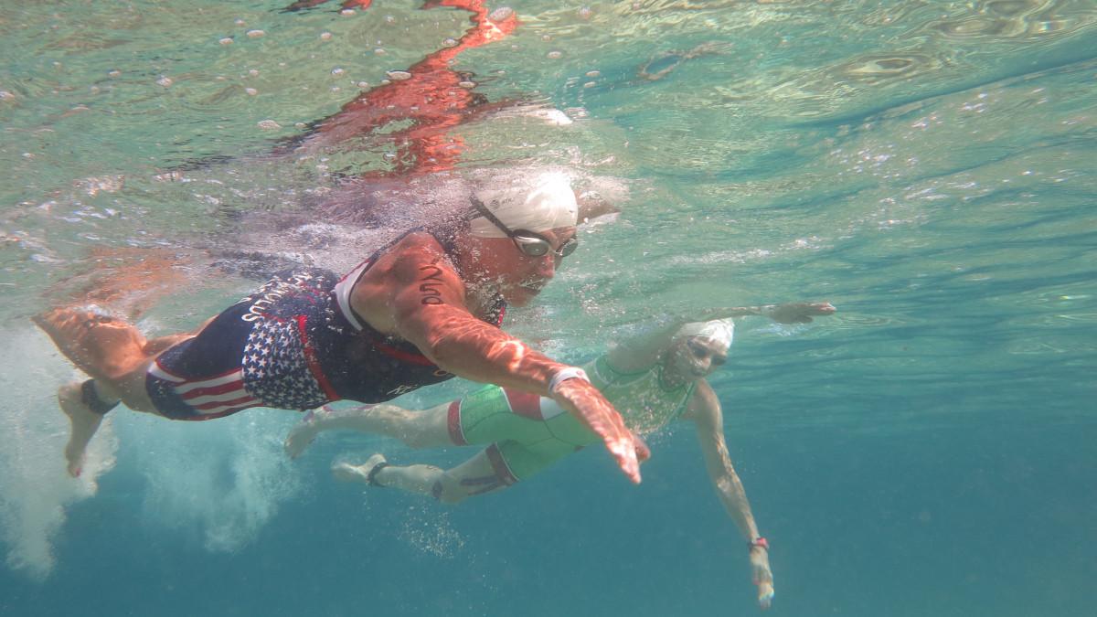 Sue Engle Reynolds '76 swimming during triathlon