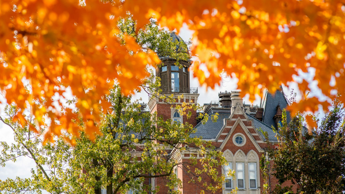 East College surrounded by fall leaves